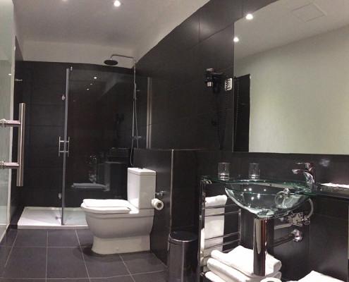 baño habitación quíntuple